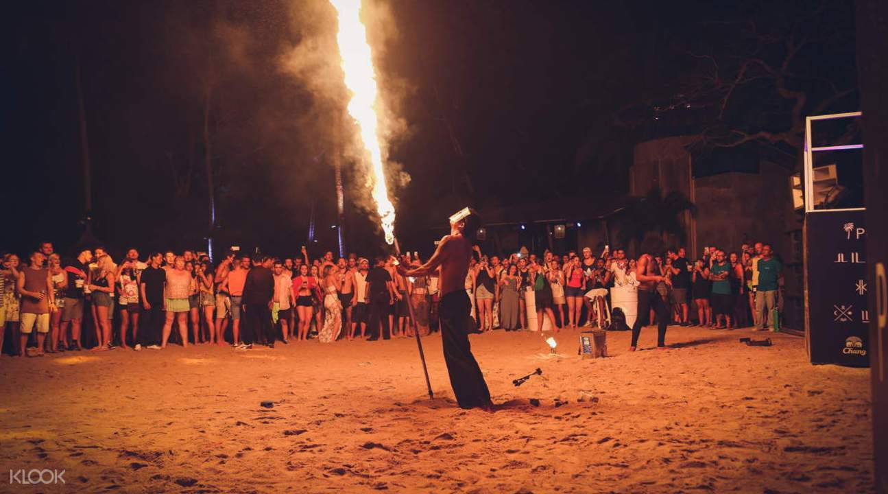 fire dancer performing at the Full Moon Party
