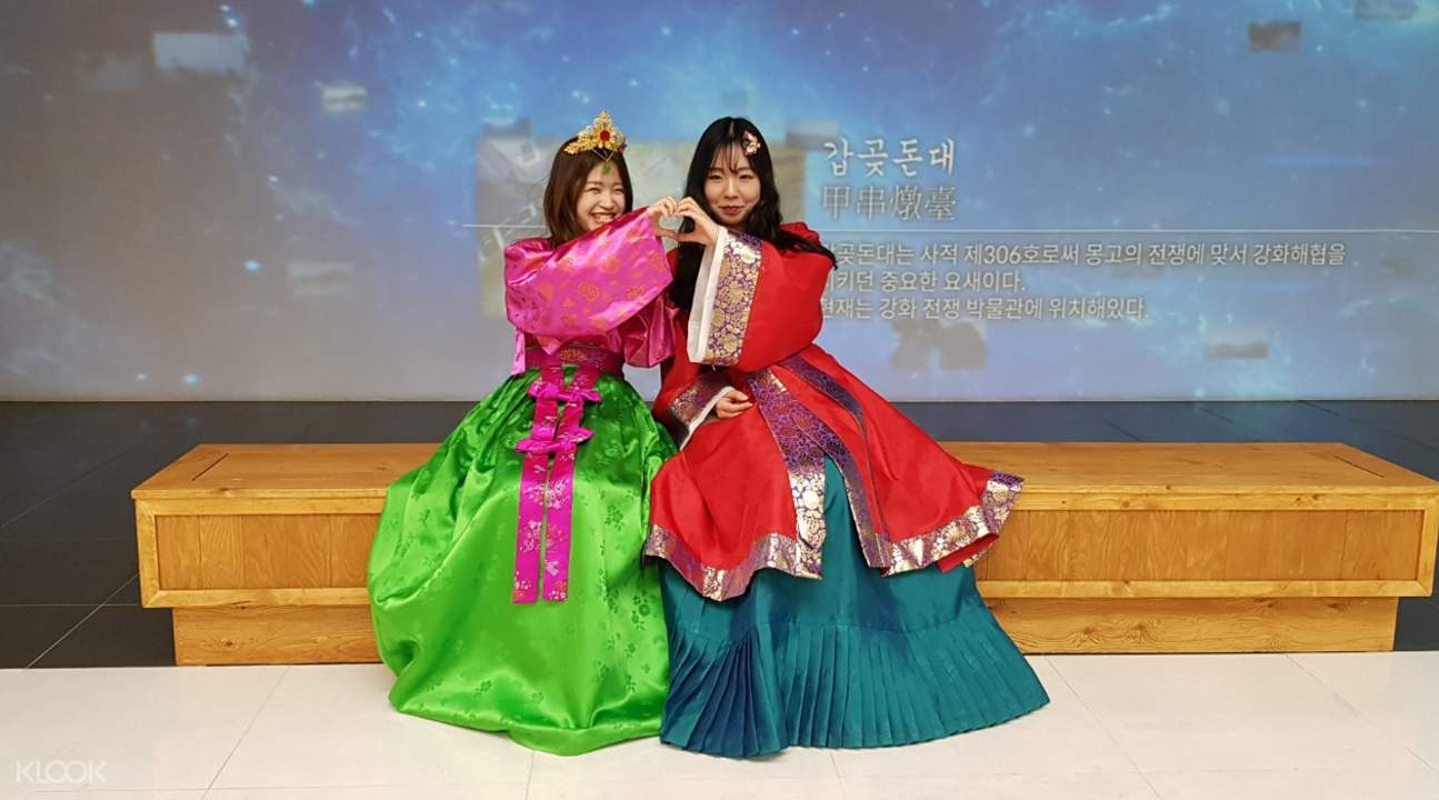 two girls dressed in vibrant hanbok