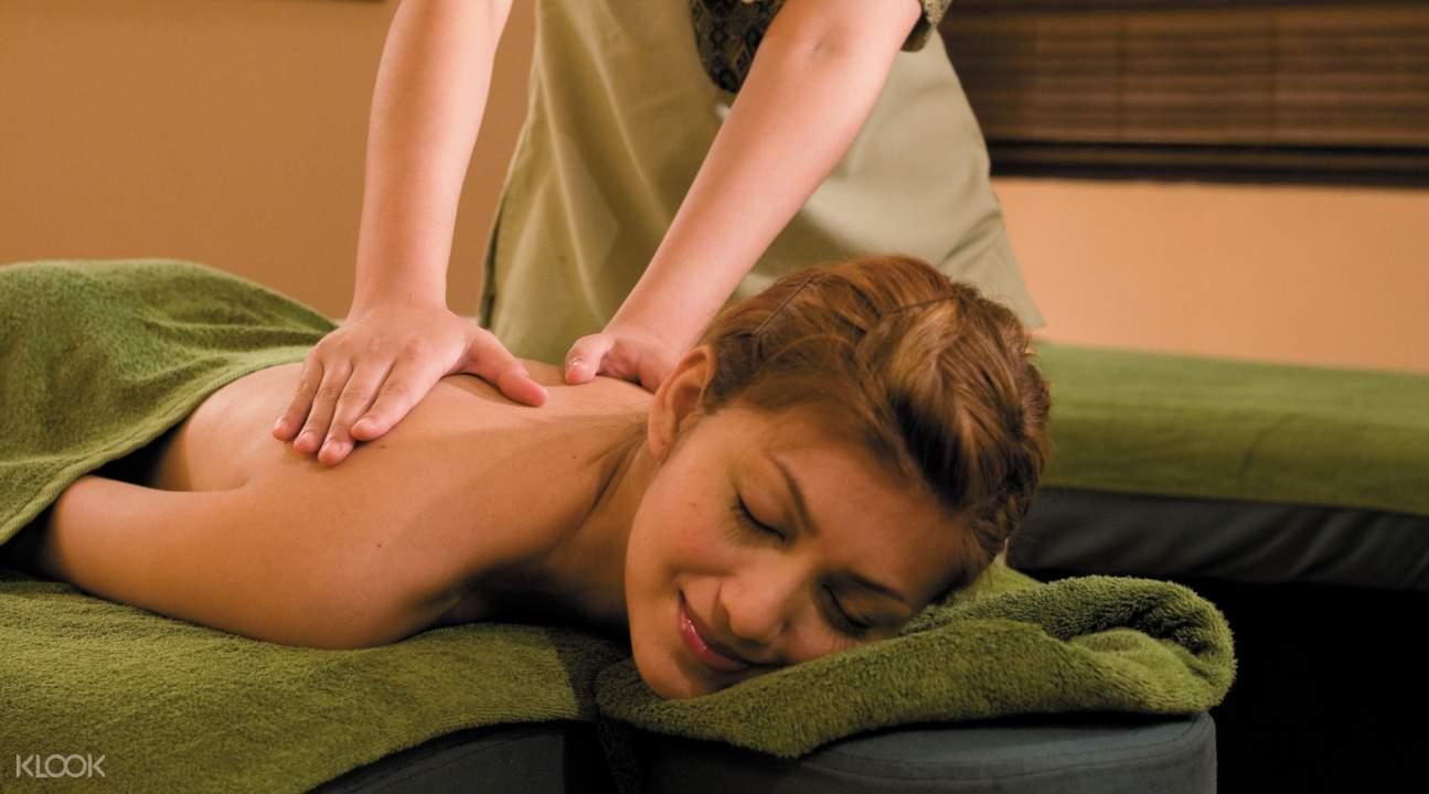 woman getting massage Shangri-la's Rasa Ria Resort & Spa