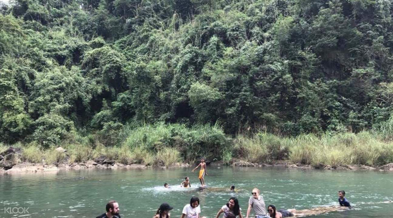 tourists bathe in the river