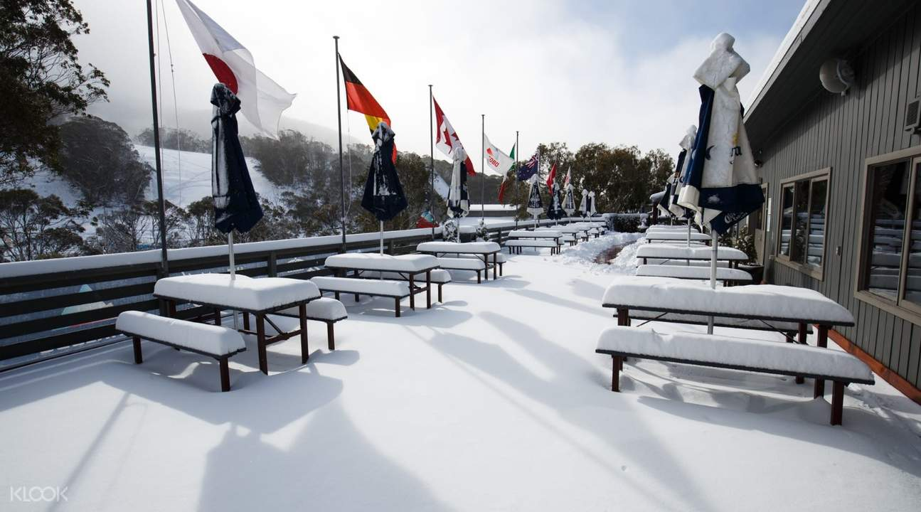 tables covered in snow in thredbo resort in australia