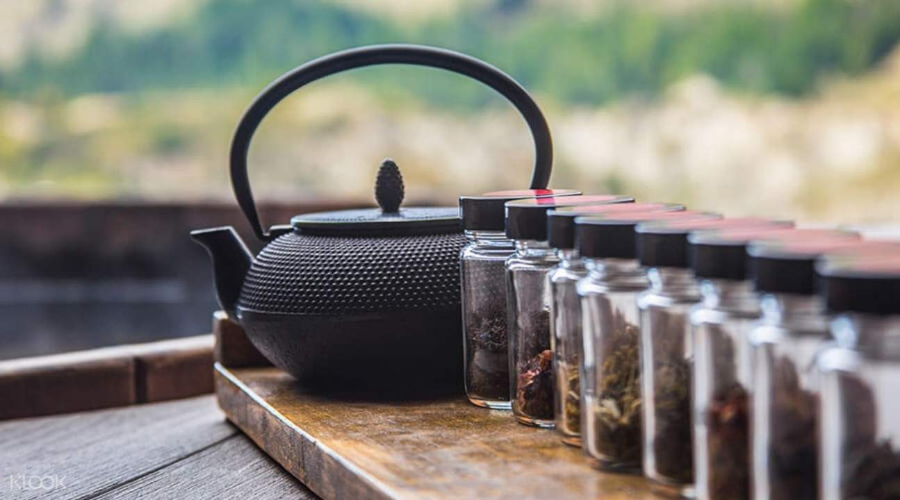 tea pot with tea leaves next to onsen hot pool