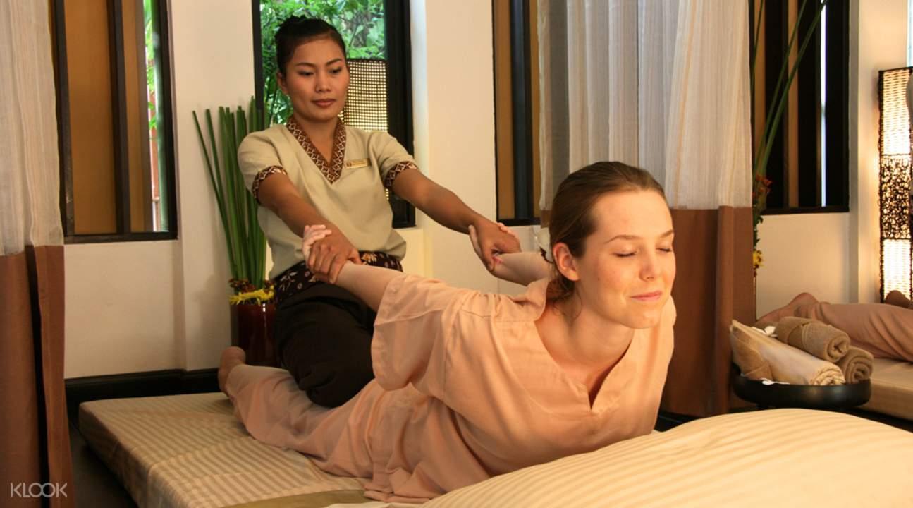 woman being back massaged