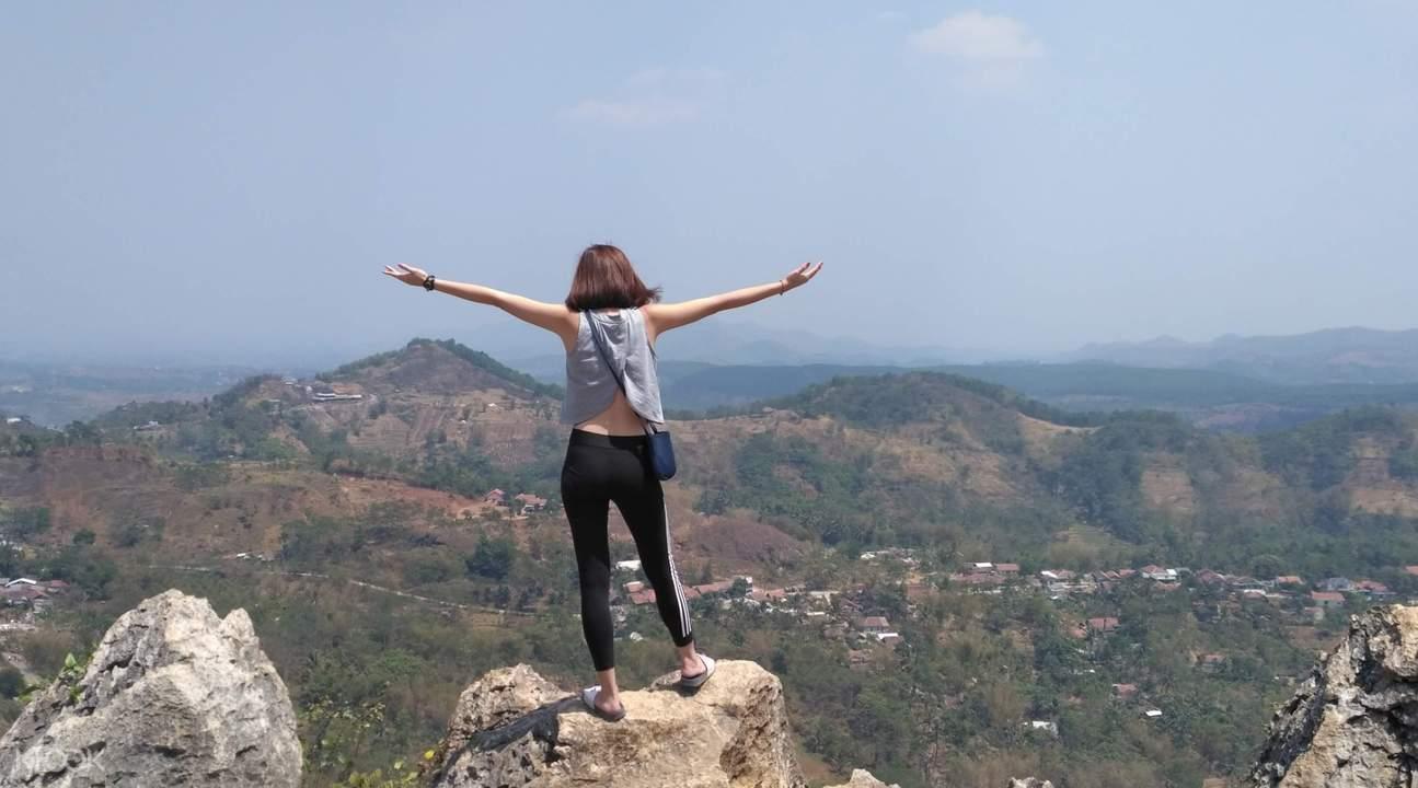 woman on top of overlooking mountain