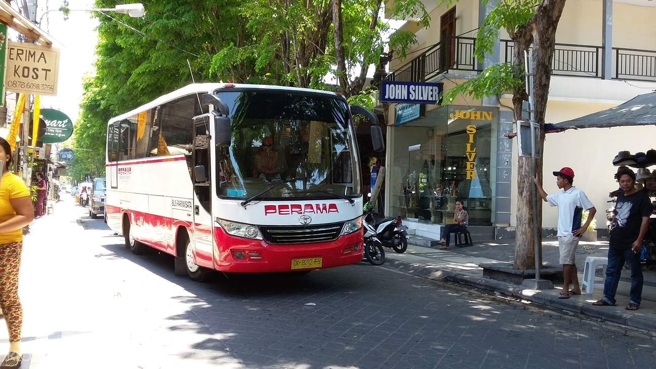 red and white minibus in bali