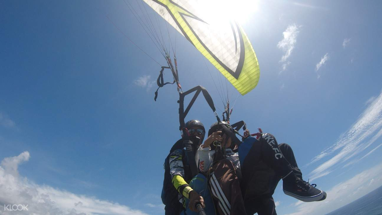 several people paragliding over timbis beach
