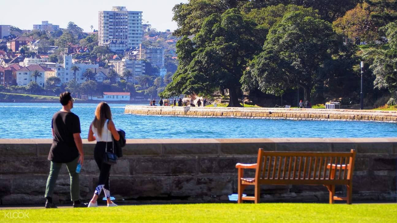 walking path along sea wall in sydney royal botanic garden