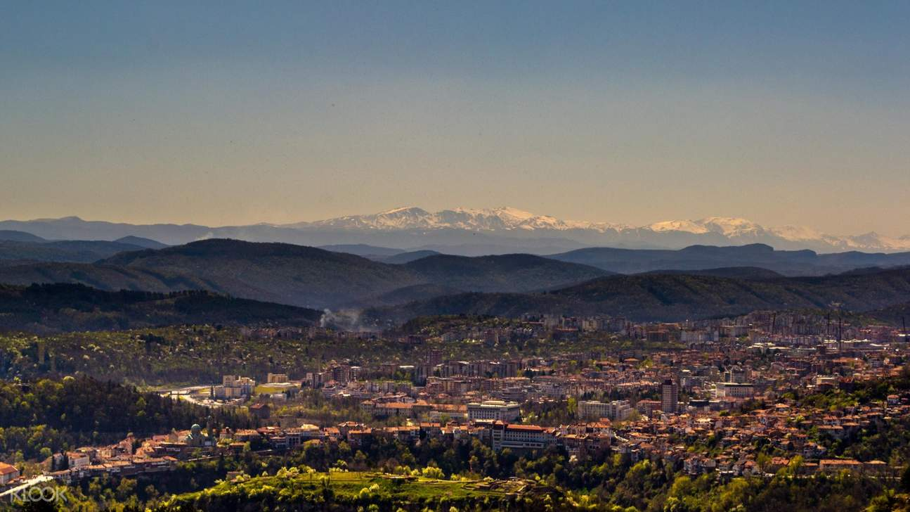 panoramic views of a city and the mountains