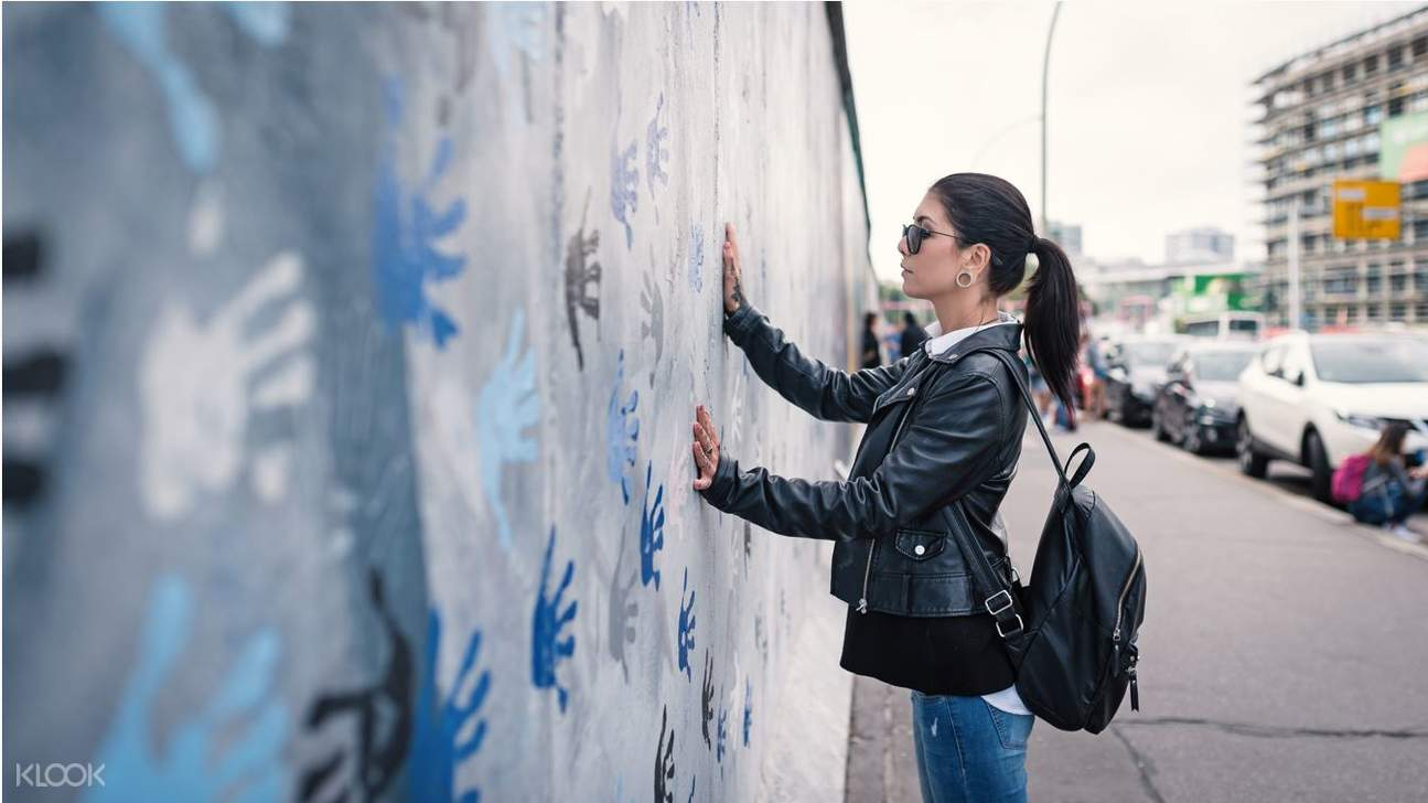 girl in berlin wall
