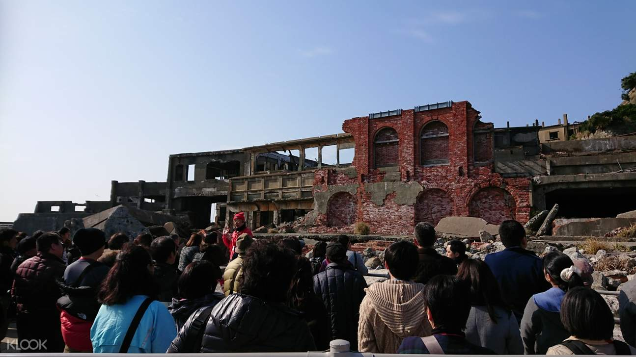 tourists explore battleship island