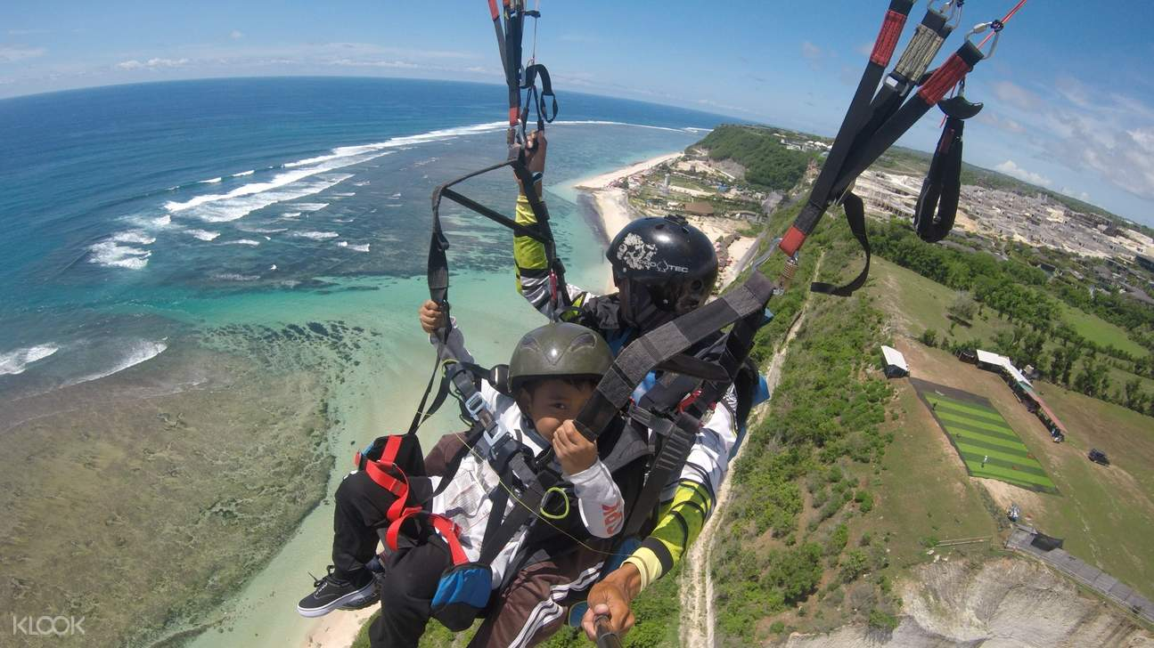 child paragliding with adult at timbis beach