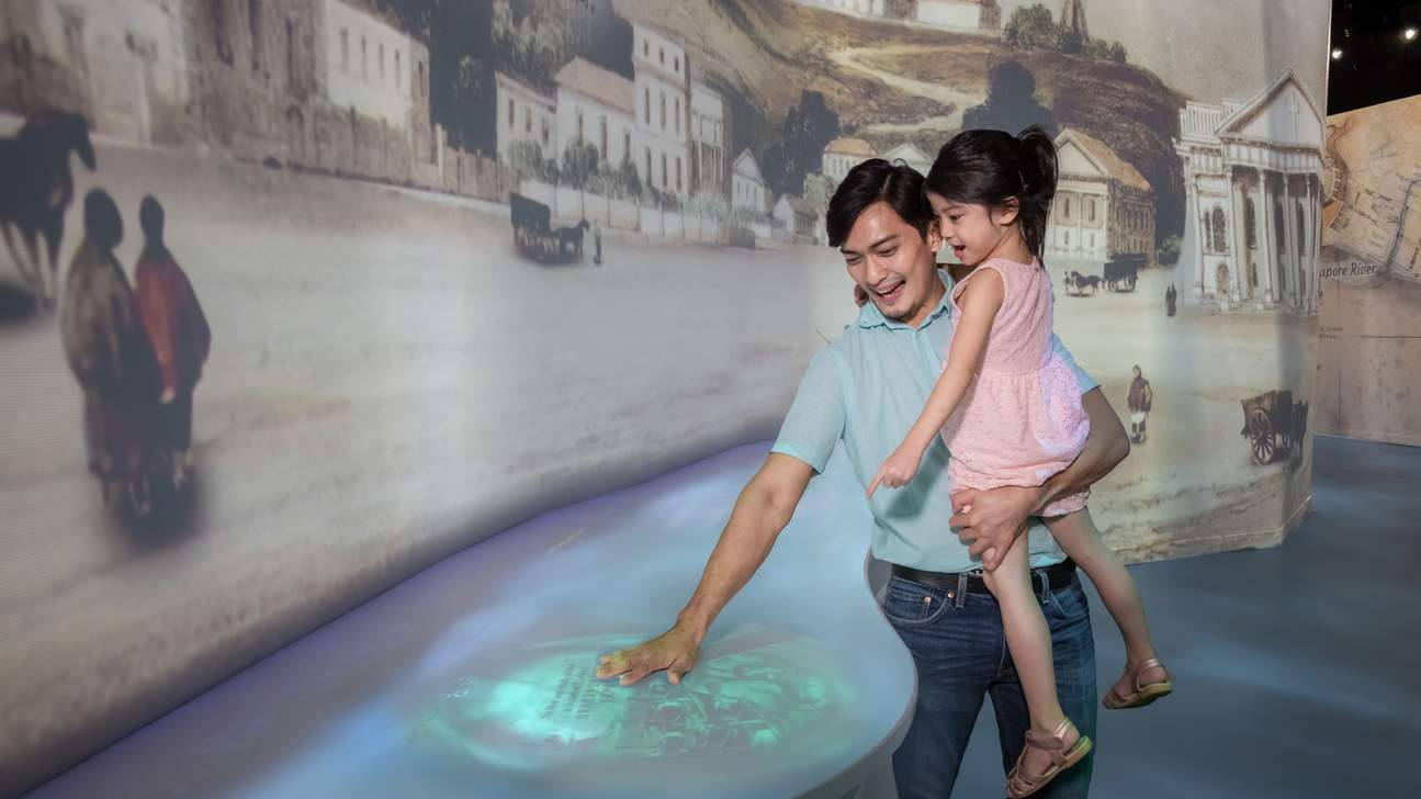 a dad and his daughter in the Singapore Flyer Time Capsule