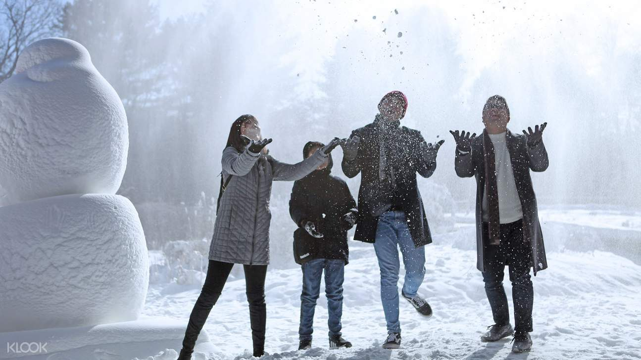family throwing snow at nami island
