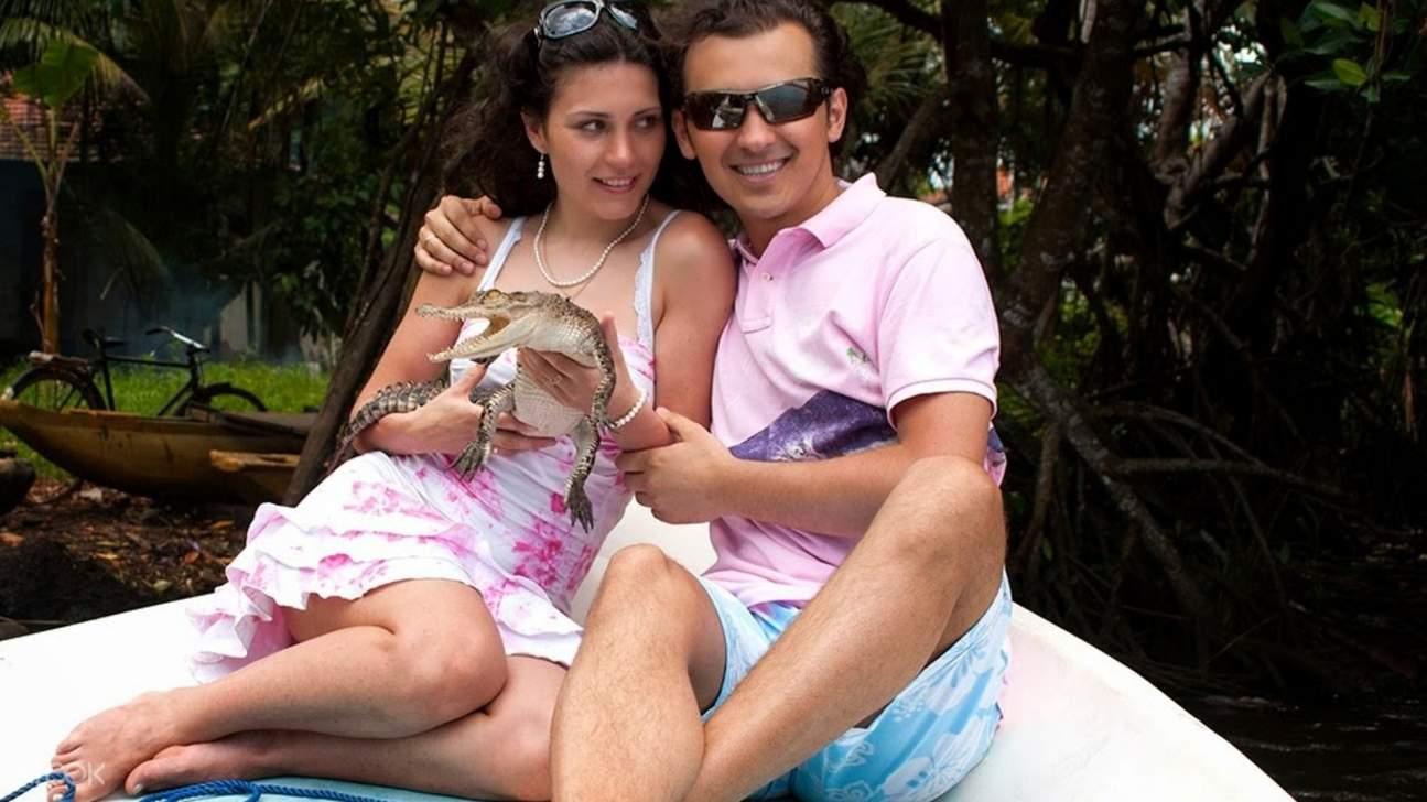 couple holding animal in bentota mangrove river safari