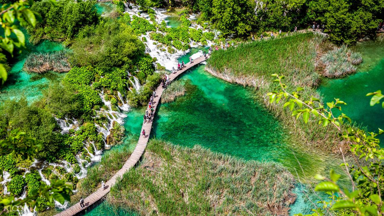 a bird's-eye view of people exploring the Plitvice Lakes National Park