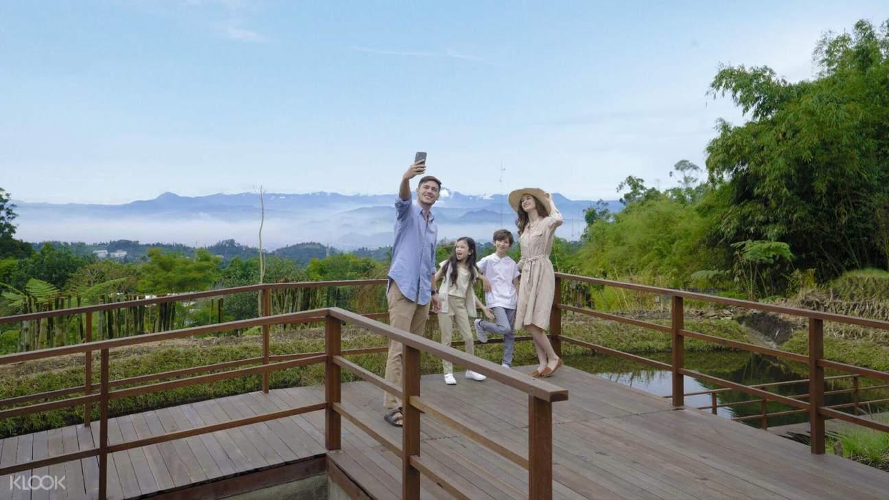 family hanging out in dusun bambu