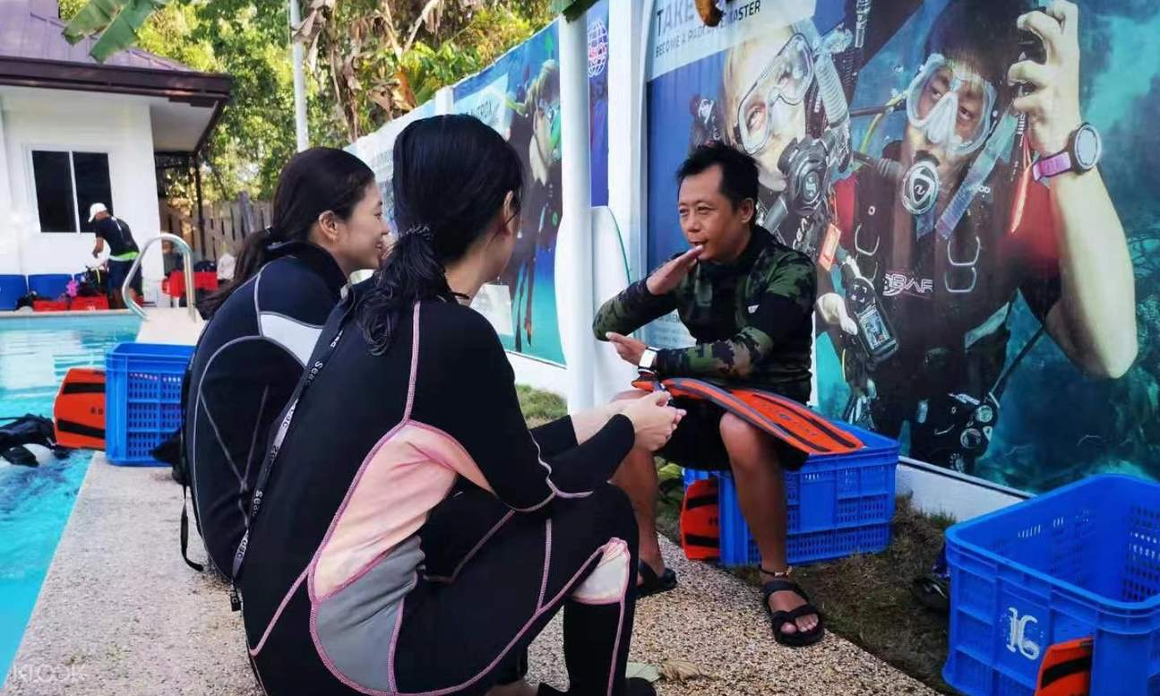 scuba diving instructor talking to people