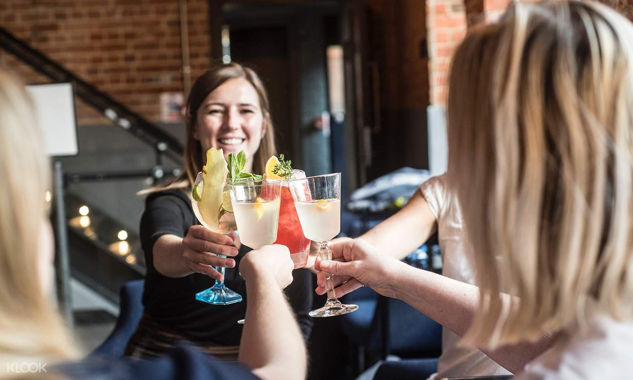 group of women clinking their cocktail glasses
