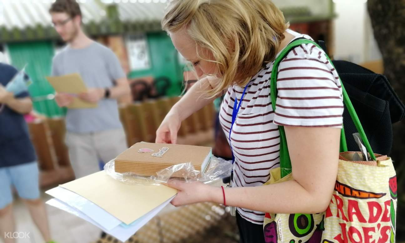 woman holding activity materials