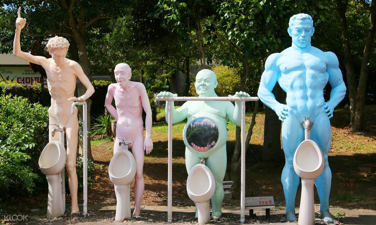 sculpture of naked men with sinks that look like urinals