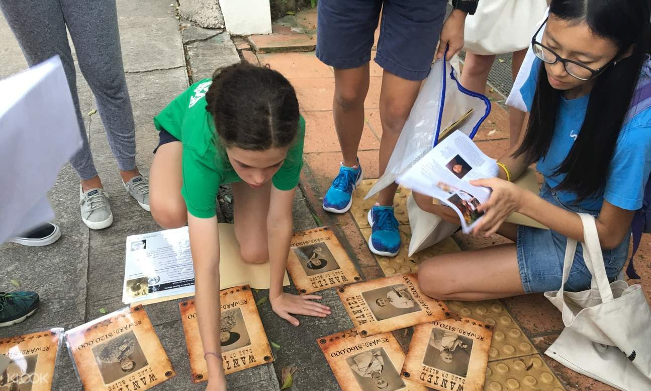 girls looking at clues on the floor