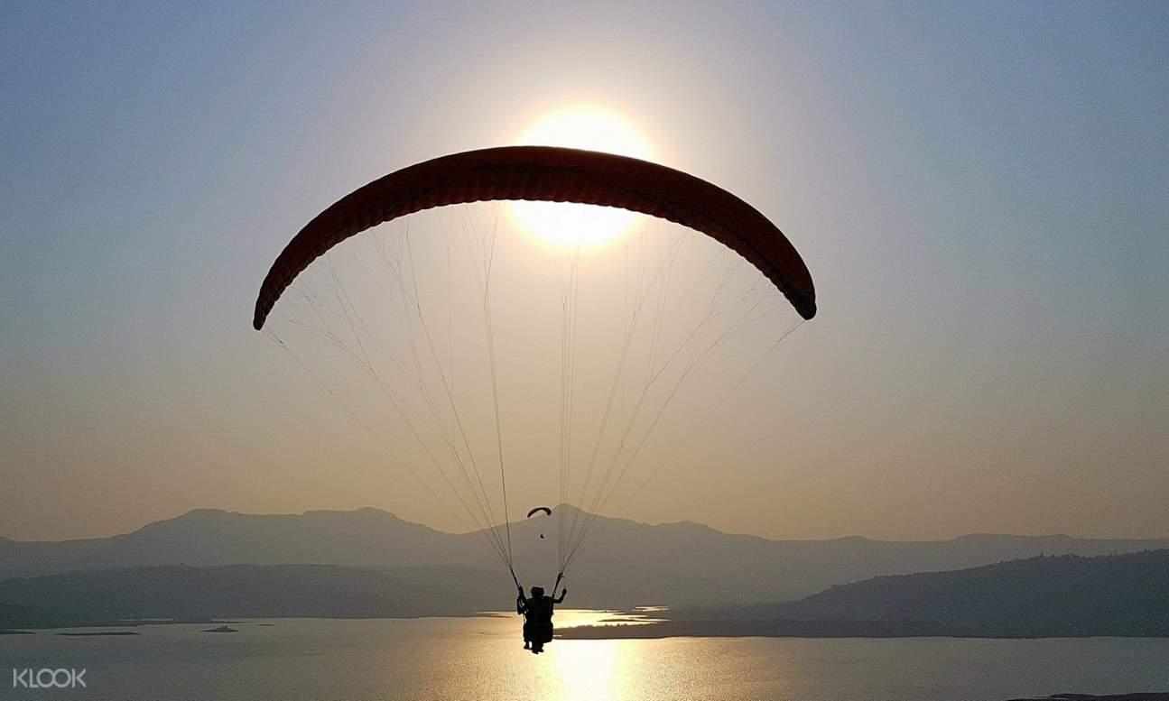 man paragliding in kamshet