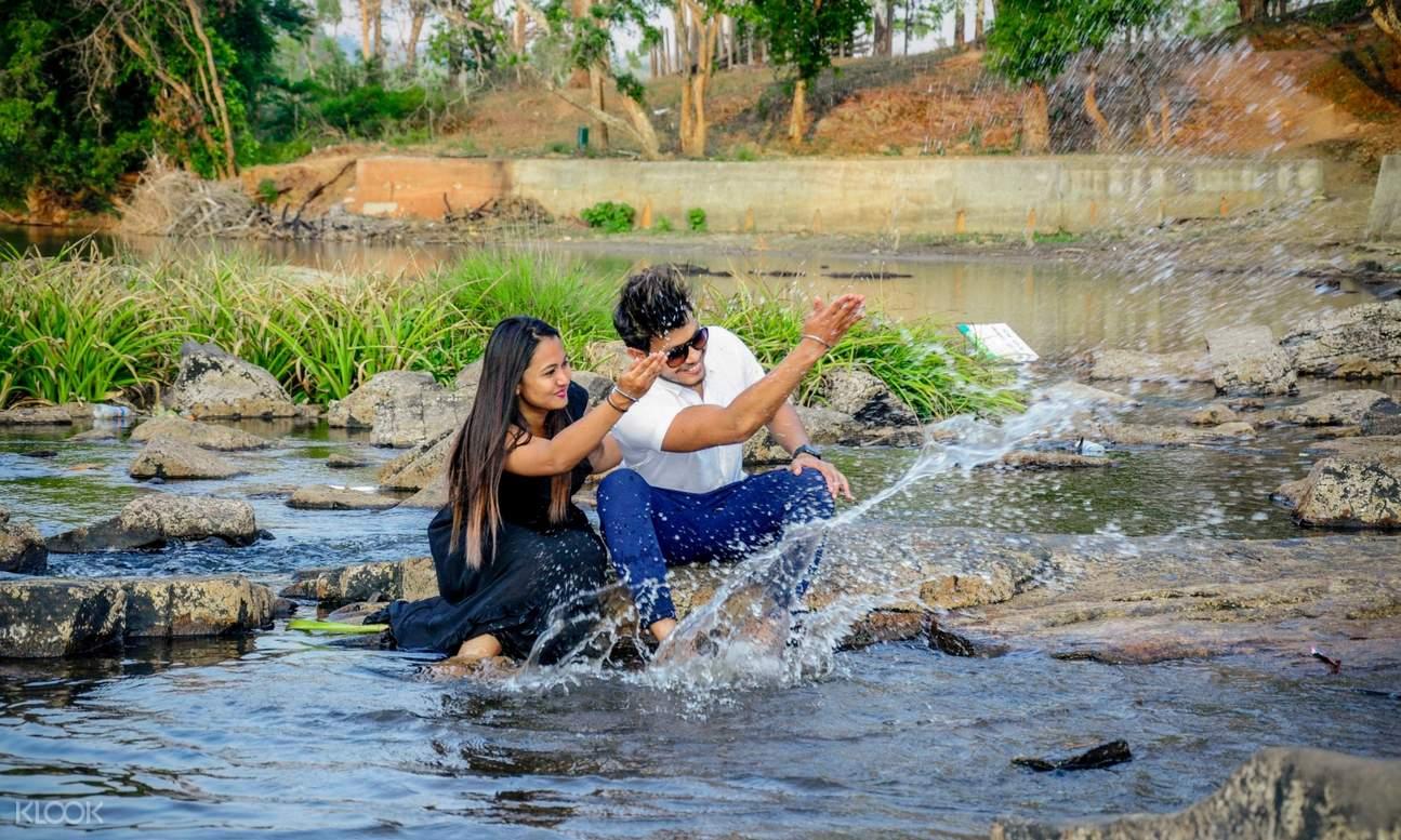 a couple splashing water