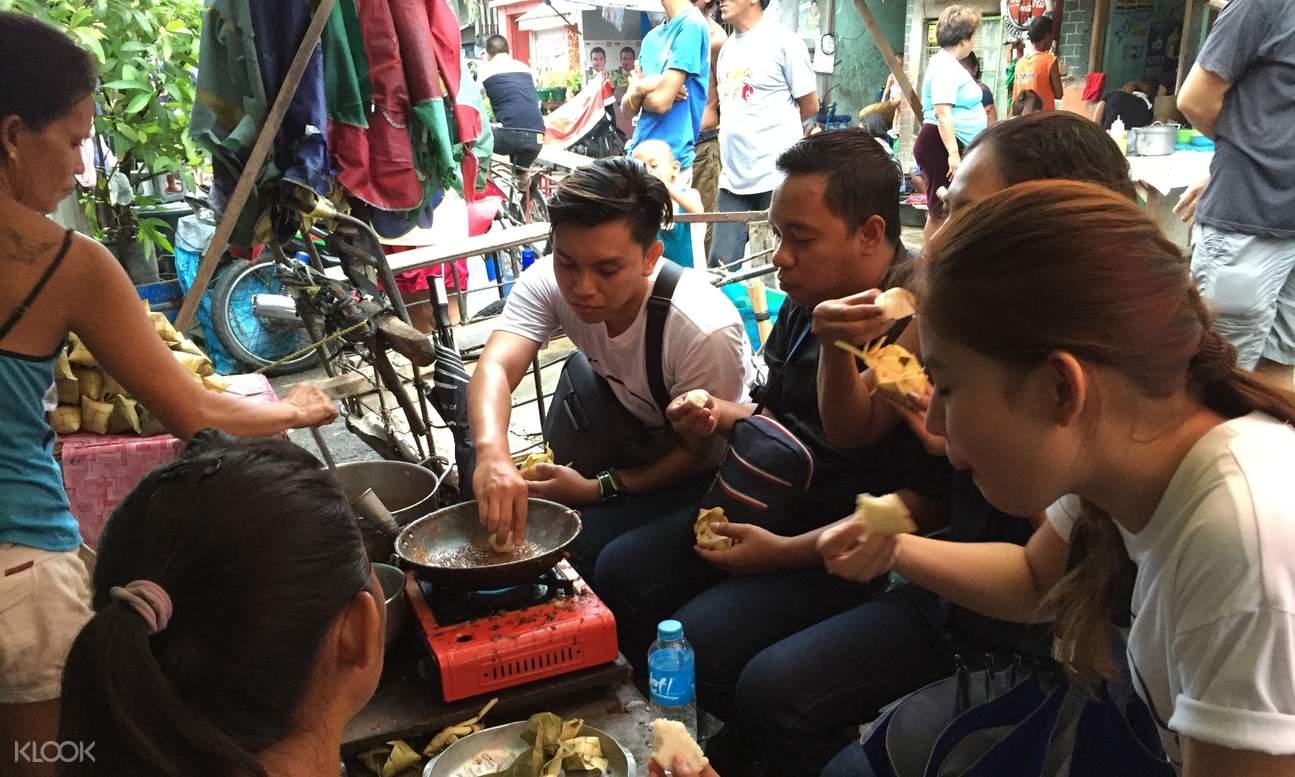 tourists eating street food