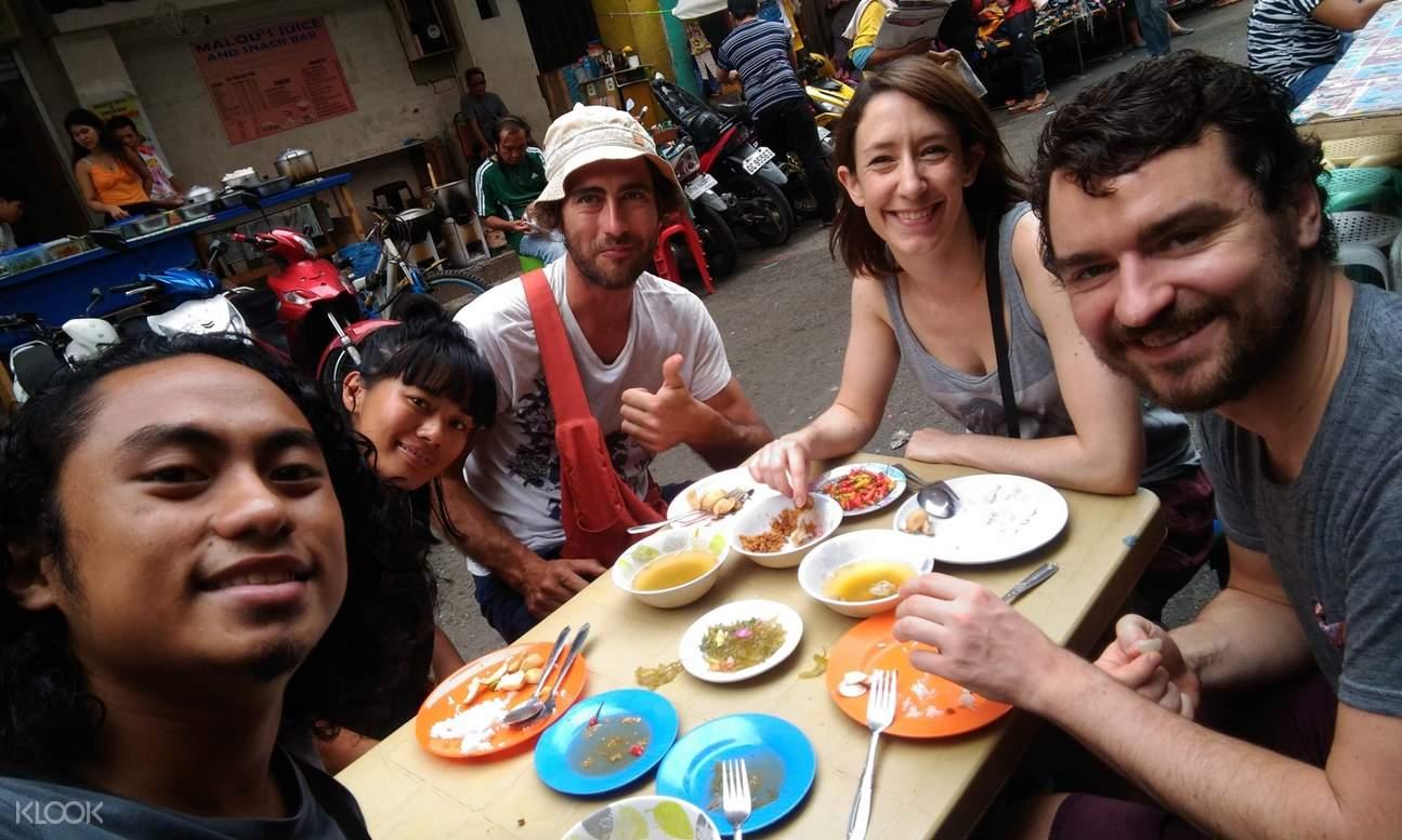 tourists taking photo with cebuano food