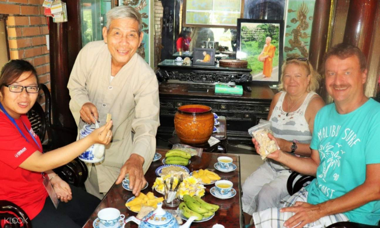 tour group enjoying snacks with local