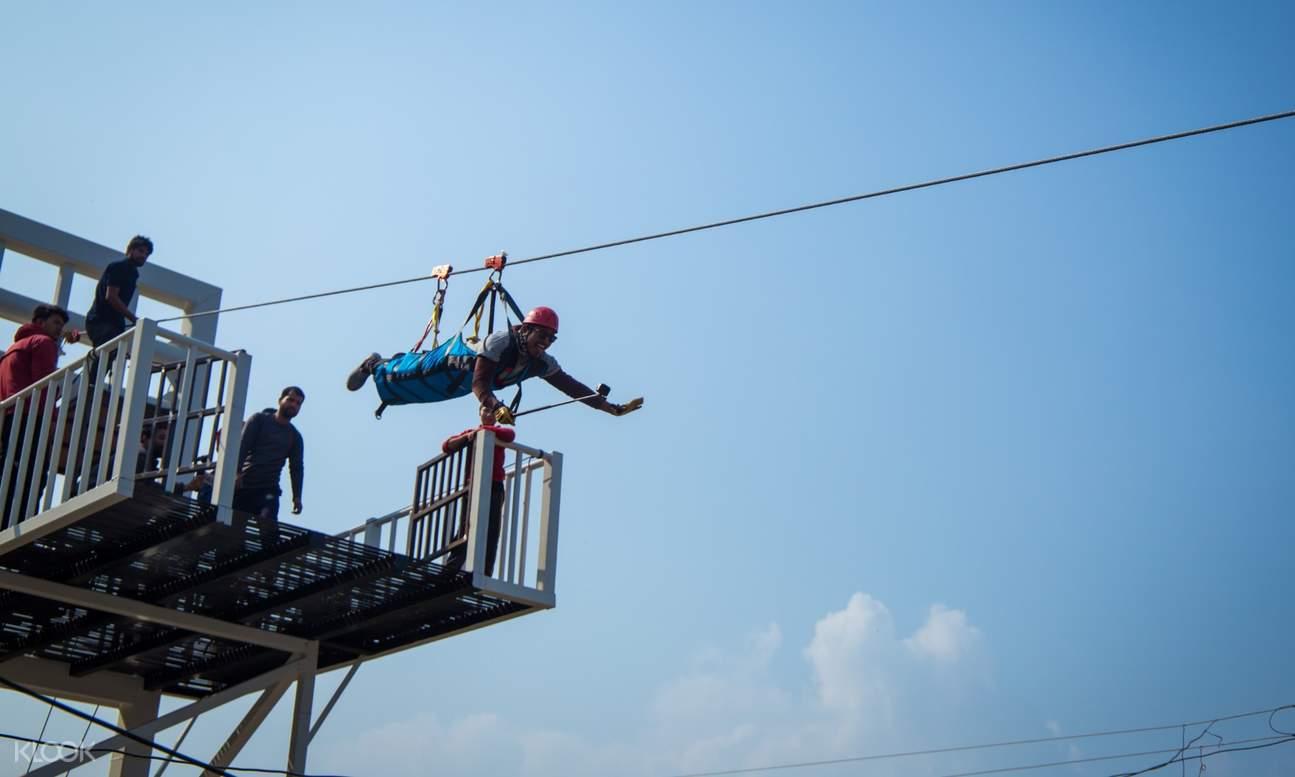 man riding a zipline
