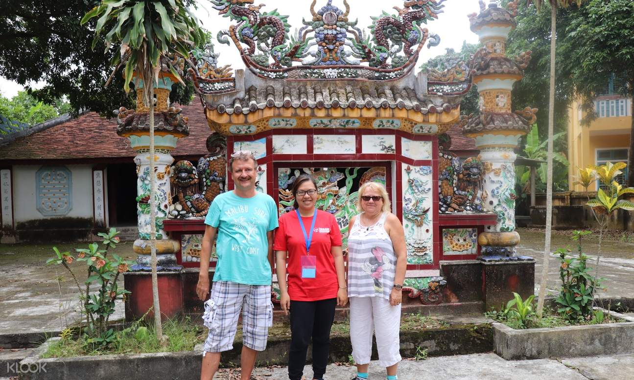 people in front of an ancient house in Thuy Bieu