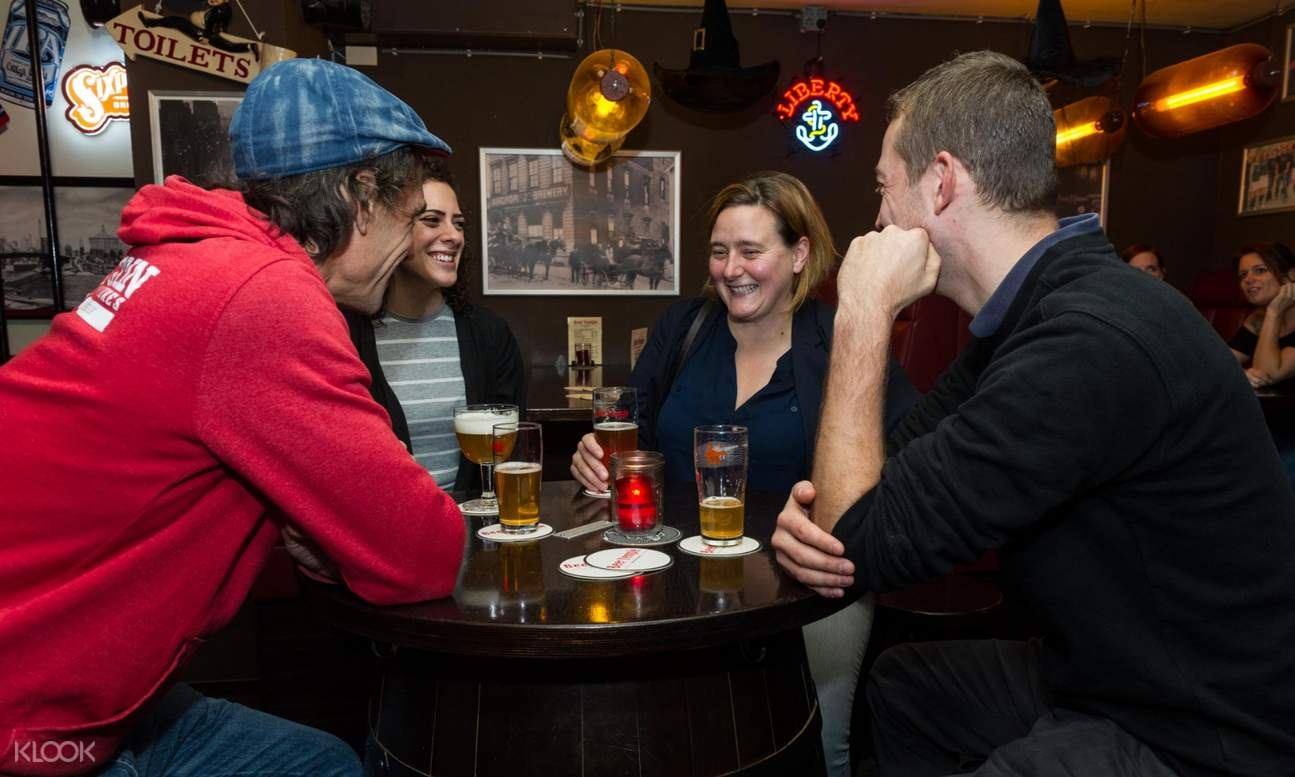 group of people chatting over drinks