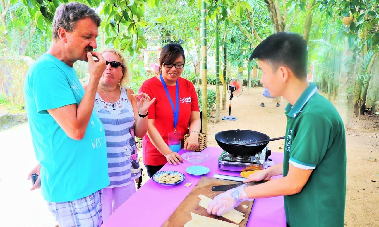 tourists tasting sesame candy