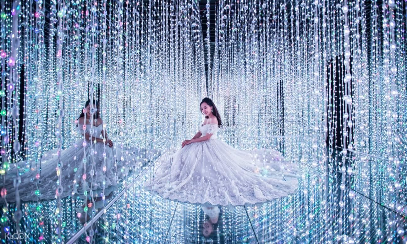 girl at crystal exhibit in lumiere dalat light garden vietnam