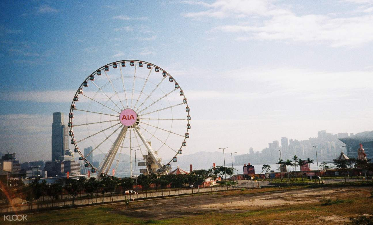 a view of the hong kong observation wheel and the city
