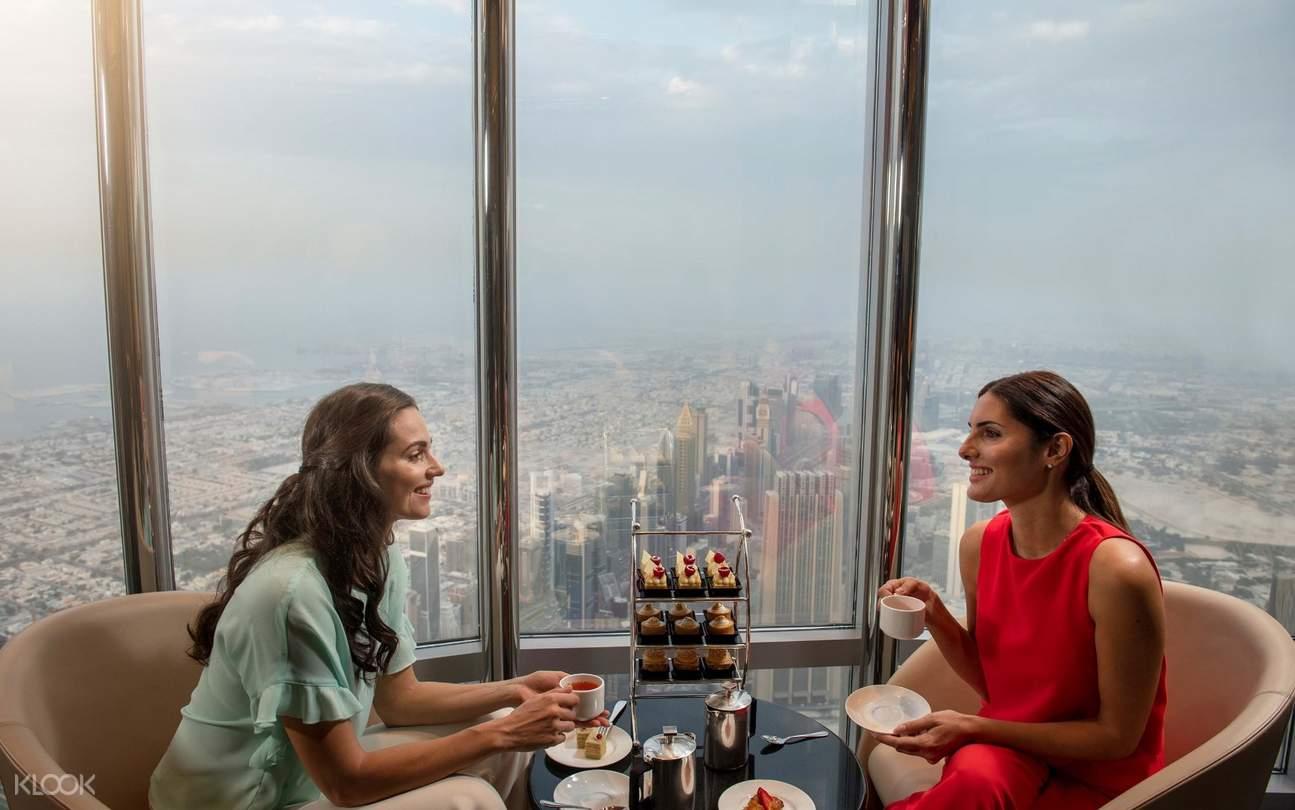 girls having afternoon tea in the lounge burj khalifa
