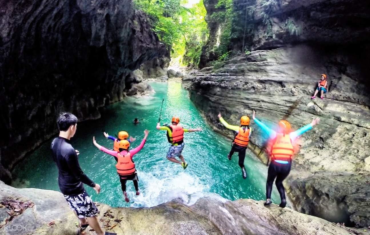 Cliff Jumping at Badian Canyoneering Adventure and Kawasan Waterfalls Join In Tour from Cebu