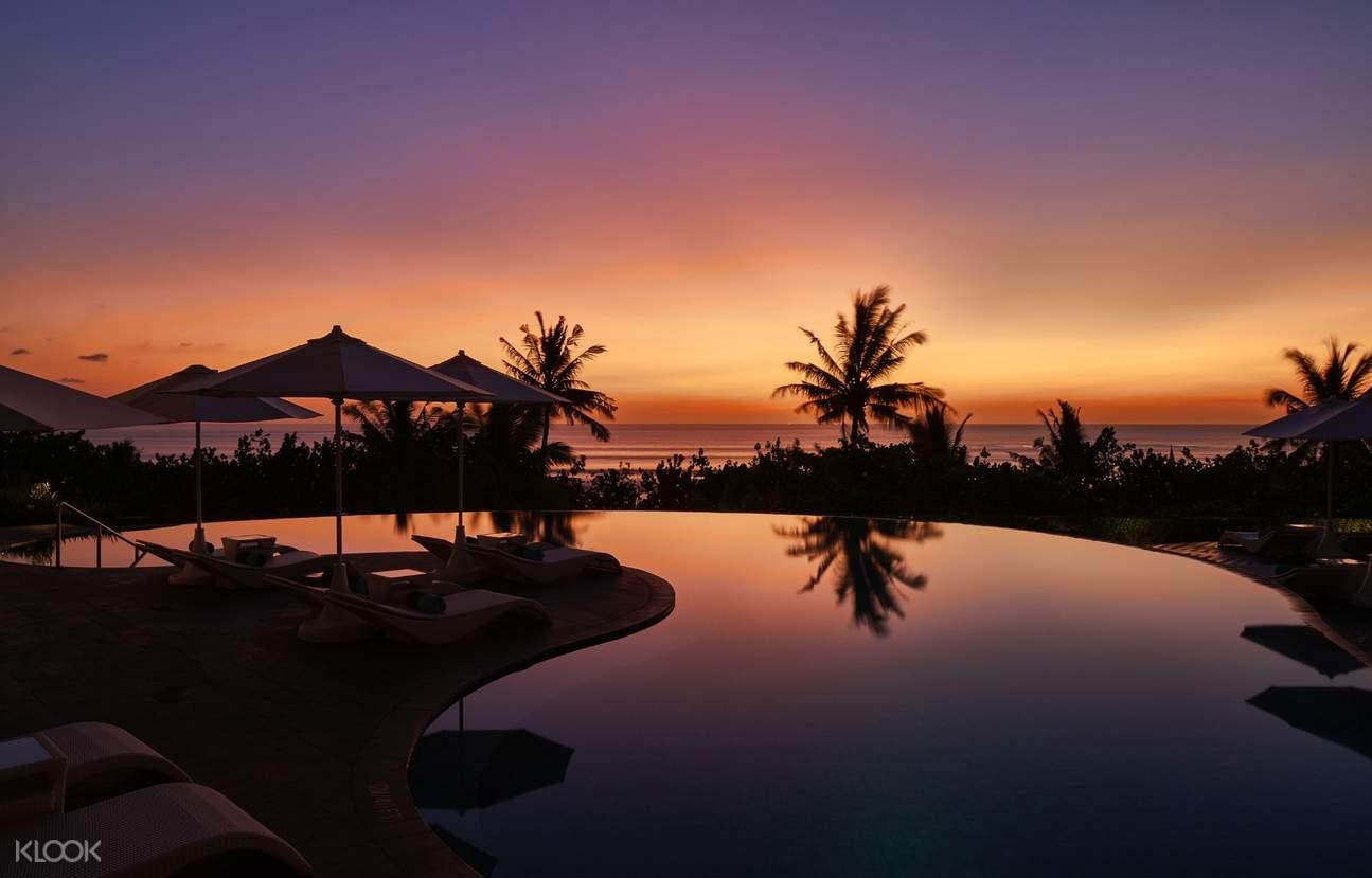 sunset over the pool at  Sheraton Bali Kuta Resort