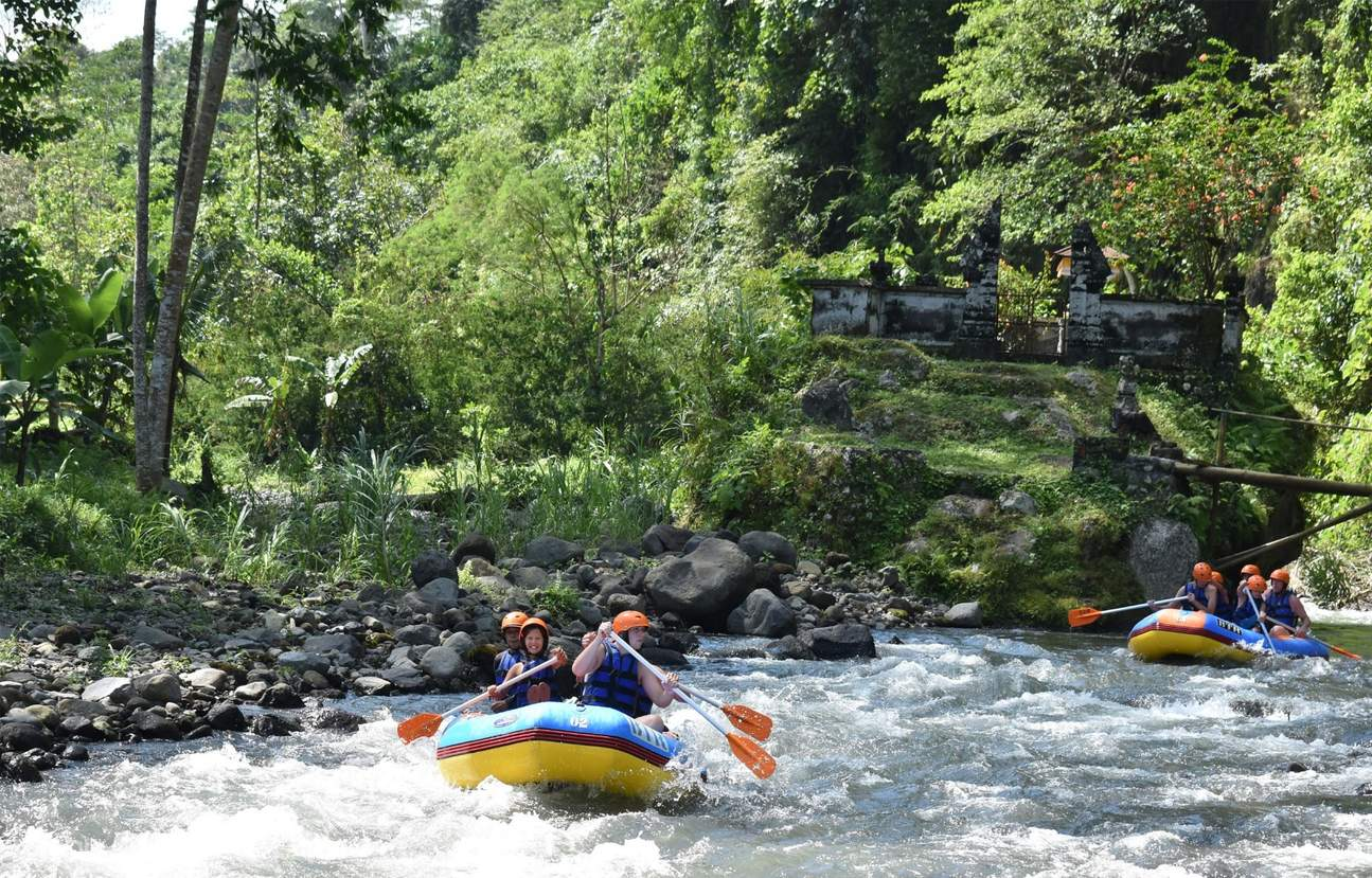 group on raft cruising through Telaga Waja River