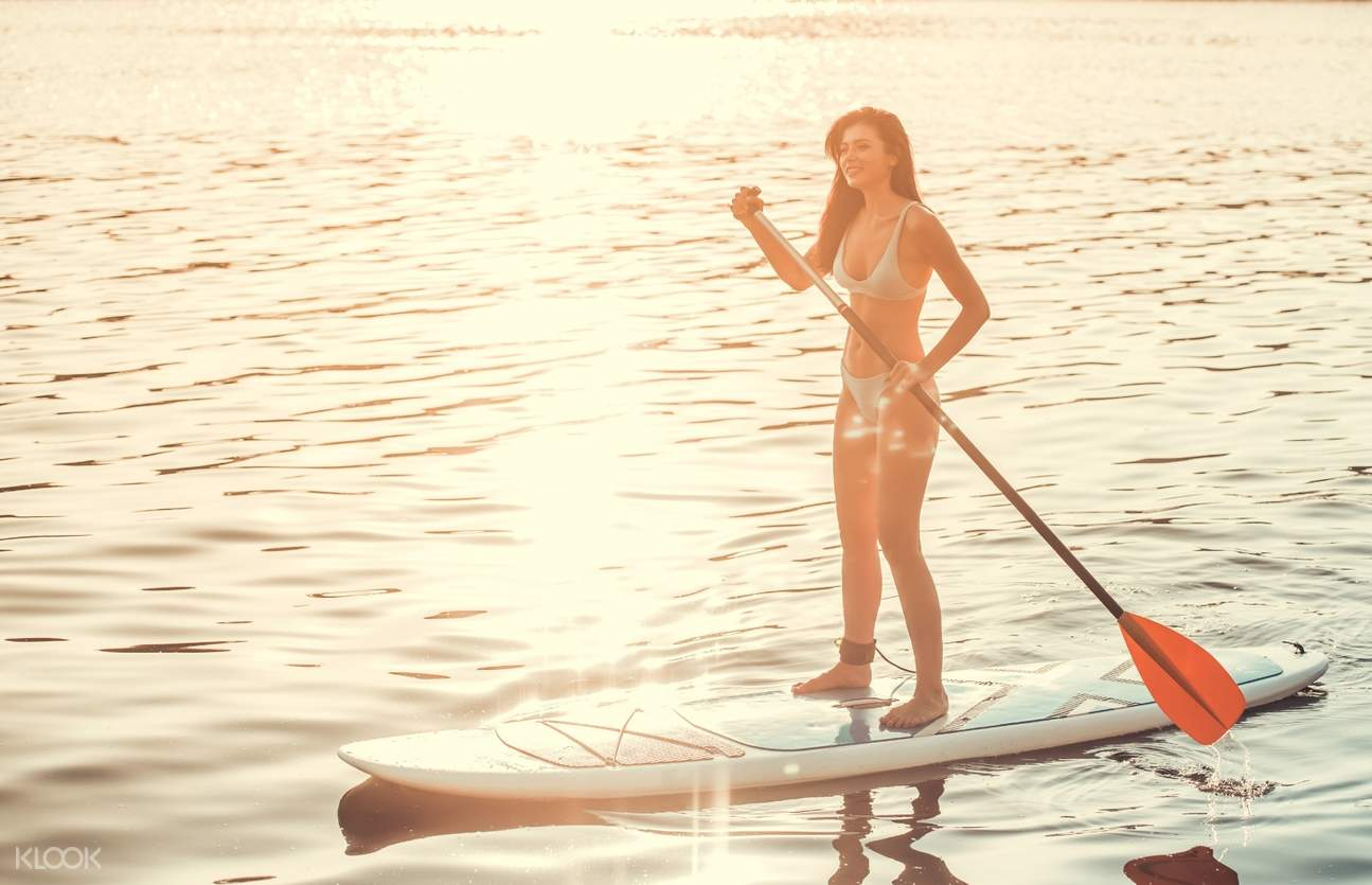 woman stand up paddleboarding in boracay