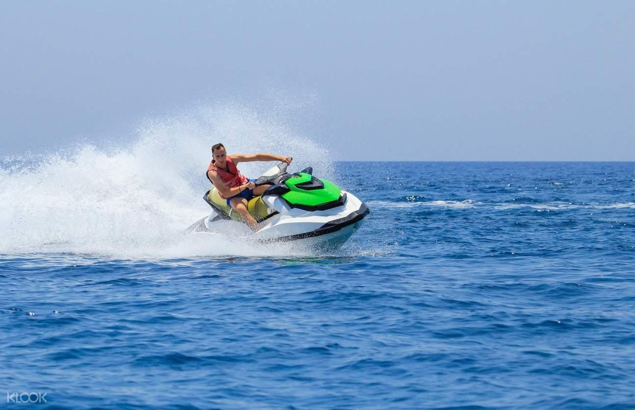 tourist enjoy a jet ski ride