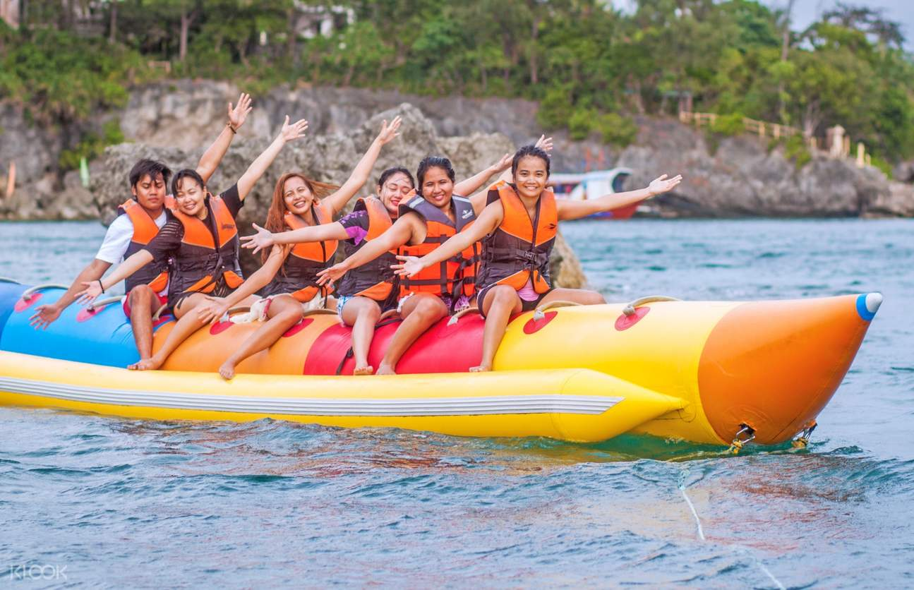 people smiling while on a banana boat