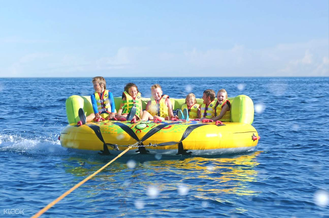 people on an inflatable vessel