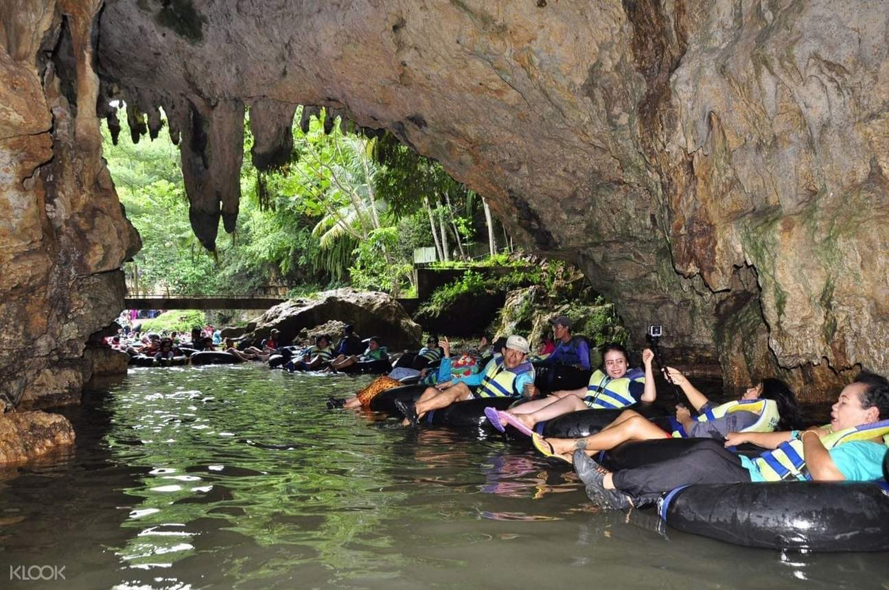 tourists riding on floaties for river tubing experience