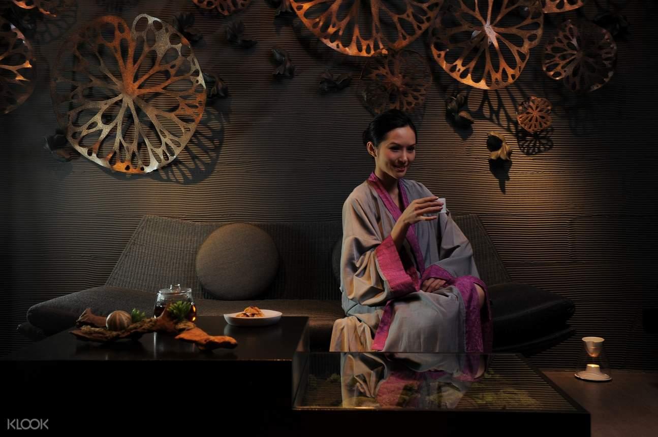 woman having tea at thann sanctuary