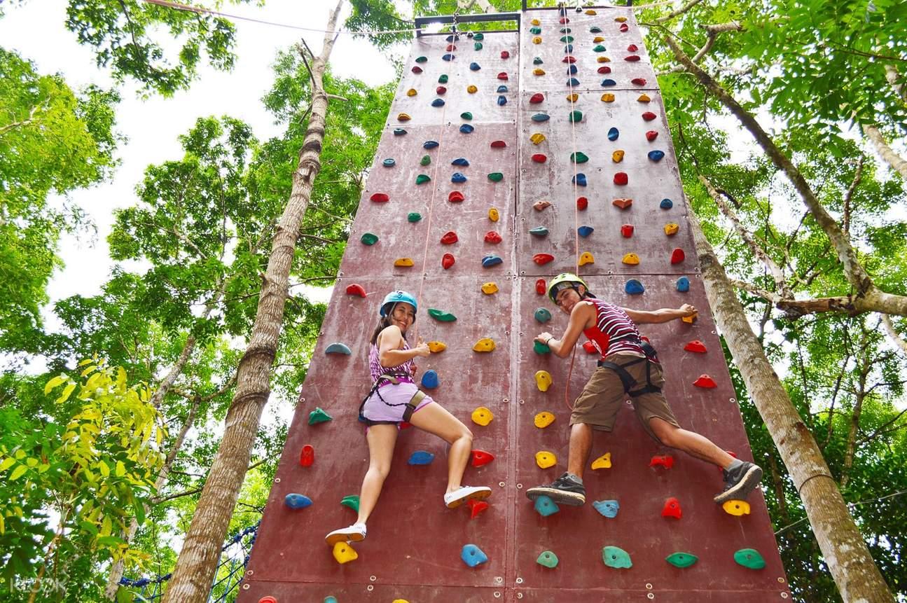 2 women wall climbing