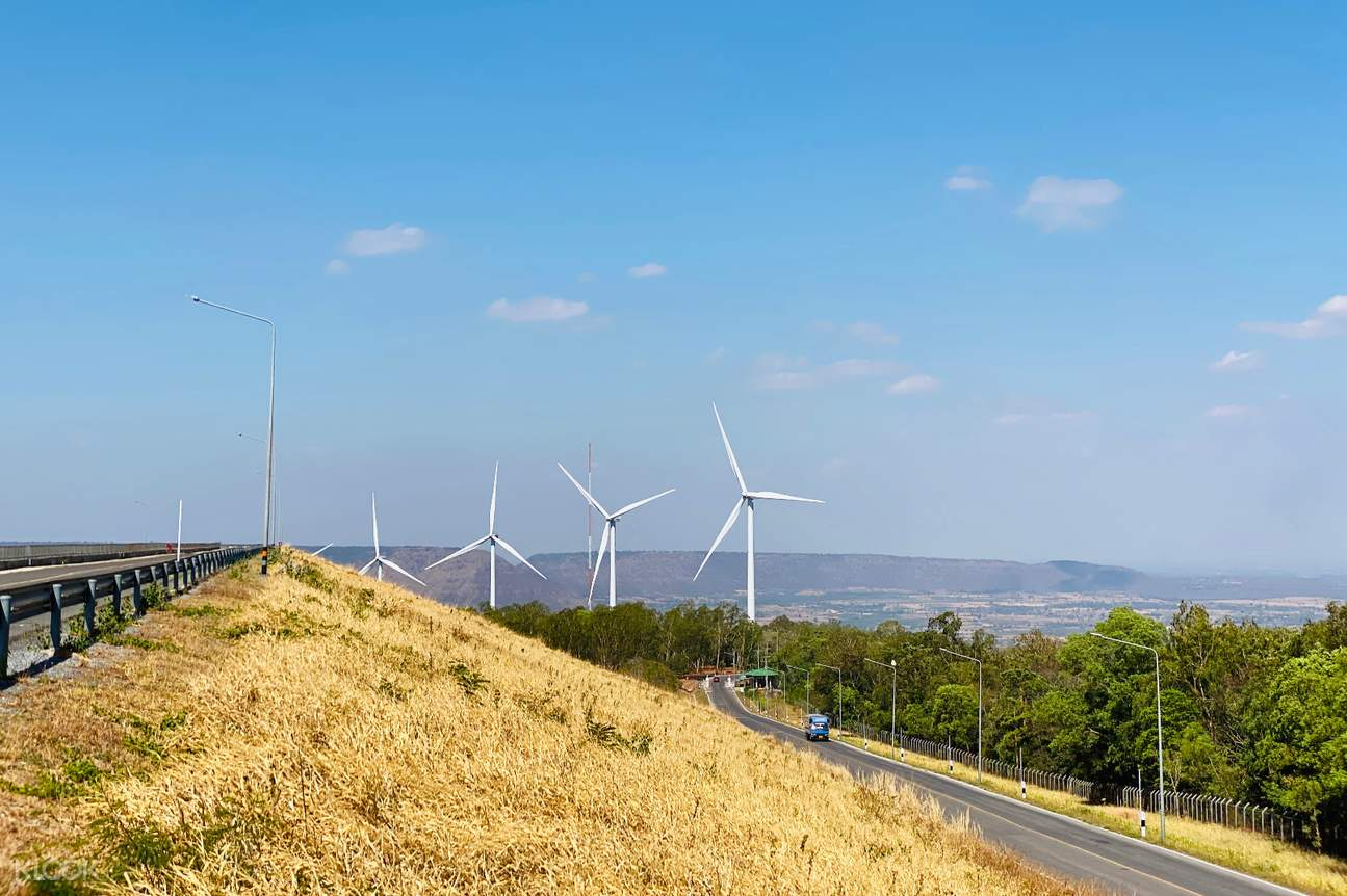 a road in Khao Yai with a view of windmills