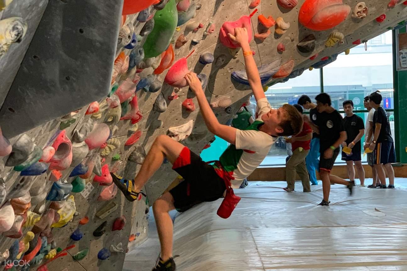 Man rocking climbing at Camp 5 in Kuala Lumpur