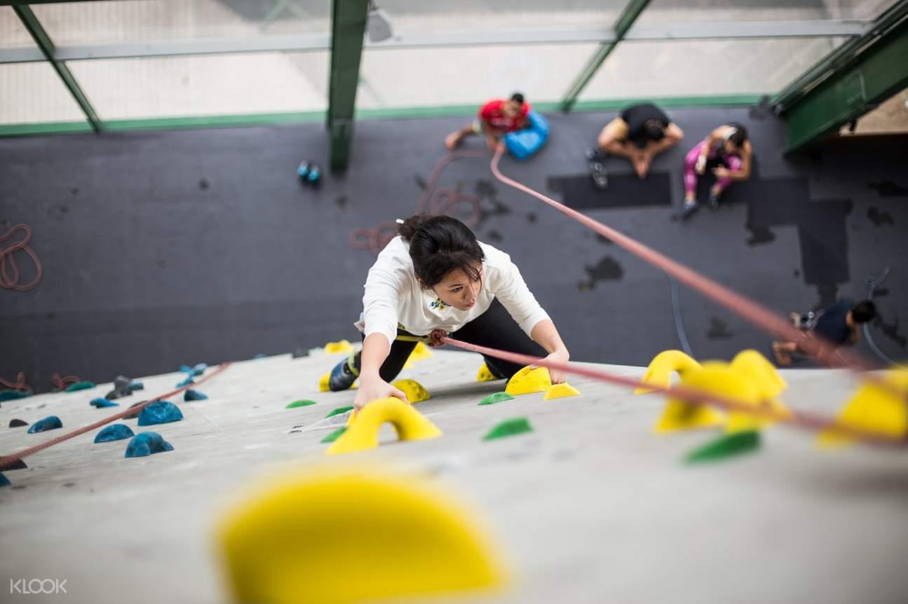 Woman rock climbing at Camp 5 in Kuala Lumpur